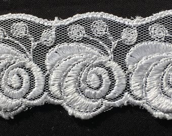 White floral lace. polyester embroidered on a tulle background, 3.5 cm wide. WH117