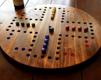 large, round, 4 player Wahoo, Aggravation board, marble game,  Wood stained Wahoo board.