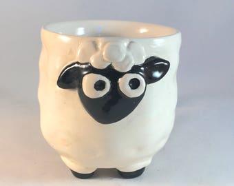 White and black ceramic sheep mug