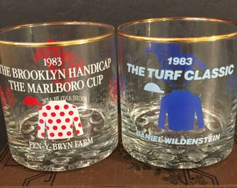 Mid Century Barware Horse Racing Glasses Set 2 NYRA Red Blue 1983 | Turf Classic Daniel Wildenstein All Along | Brooklyn Handicap Marlboro