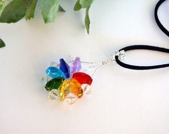 A multicolored and clear Crystal pendant necklace