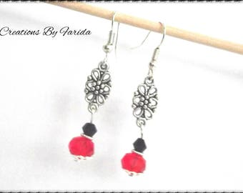 Silver plated earrings with red and black beads in floral connector