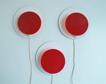 Trio of white and red wall lamps made by a Danish company called Darø in the 1980s