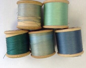 5 Silko wooden cotton reels with thread