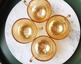 4, carnival glass teacups with embossed floral pattern