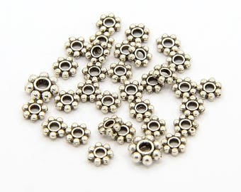100 flower spacer beads 4mm Tibetan silver