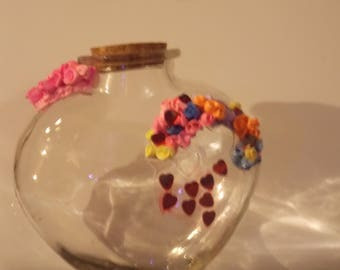 Silk clay hand made flowers on a heart shaped bottle