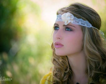 Lace adorned with a vanilla satin flower headband