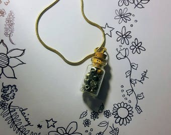 Tigers eye, gold speck and moss agate in a bottle