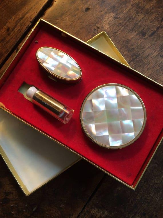 1960's mother of pearl 3 ins diameter powder compact/lipstick/lipstick  case in original box. Unused