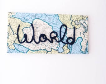 Unique deco canvas with world map paper and a word in the knitting world for your home