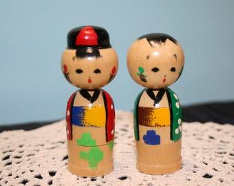 Pair of Kokeshi nodders; Japanese Kokeshi dolls, bobbleheads; boy and girl Kokeshi; 1970's Kokeshi pair