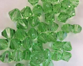8 mm Peridot Swarovski Crystal bicones