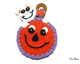 Orange Halloween crochet pumpkin potholder with ghost, presina zucca arancione con fantasma per Halloween all'uncinetto