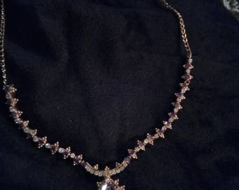 Purple and clear crystal necklace with center focal.