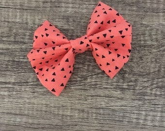 Peach with black triangle bow
