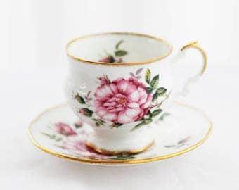 Elizabethan; large flower pink TEACUP and saucer, pure white base, gold sprinkled rims, England