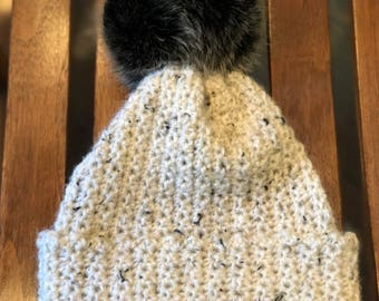 White with black speckles crochet slouchy or cuff  beanie with  black faux fur pom pom