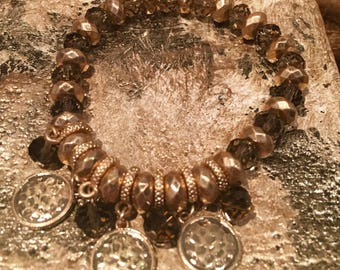 Smokey Gold stretch bead bracelet with disc antique gold tone hammered accent charms
