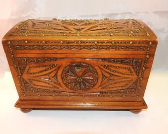 vintage hand carved wooden box with yellow metal decoration