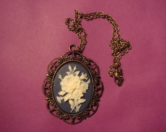 large format with a white flower cameo pendant