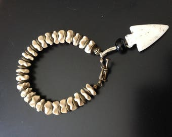 Bronze bracelet with pearls, beads accented with a bone arrow carved coconut