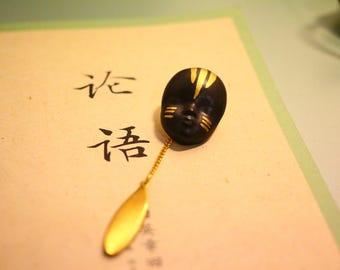 black gold ceramic face fancy brooch, pendant bronze