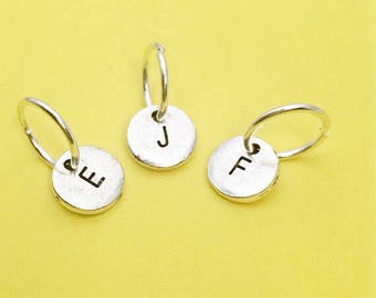 ADD a additional hand stamped initial charm to an existing order.