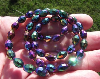 3 SWAROVSKI CRYSTAL BEADS HAVE FACETED 6X8MM.