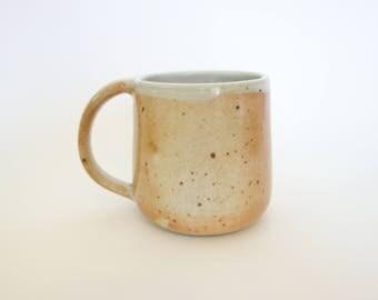 White and Orange Speckled Mug
