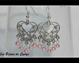 Earrings and pink glass beads