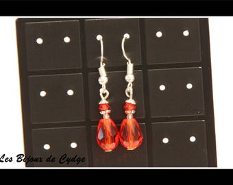 Earring and its red glass drop