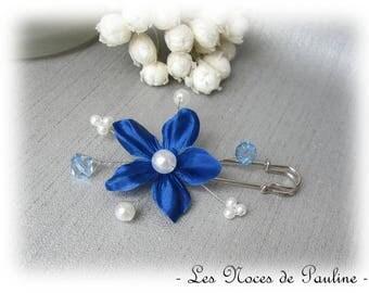 Fastener behind blue and white flower satin wedding d