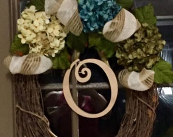 Spring time floral wreath with initial