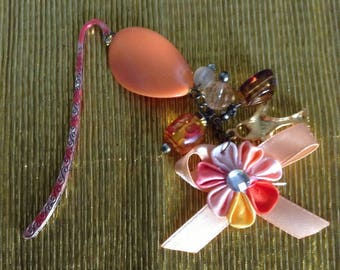 Handmade unique creation with charm and satin flower bookmark