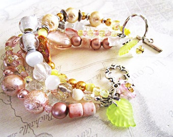 Bracelet multi rows of pastel beads, silver clasp