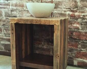 Reclaimed barn wood vanity with concrete sink