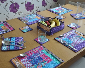 Set of  table mats, coasters, pot holders and basket. Stunning purple colour with Indian-inspired fabrics.  Avalible as a set or separately.