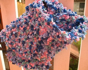 A pink and blue POMPOMS knit scarf