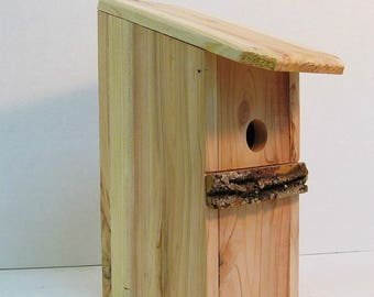 Handcrafted birdhouse with a unique bark perch, one of a kind design, easy opening for easy cleaning and maintenance