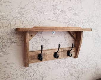 Wooden shelf with hooks