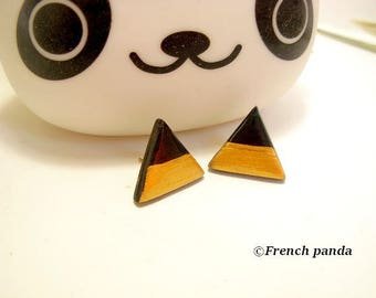 Graphic line. Pair of black gold polymer clay