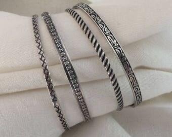 Four Vintage Sterling Silver Bangles