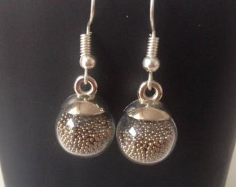 Glass and wire ball earring, bronze beads