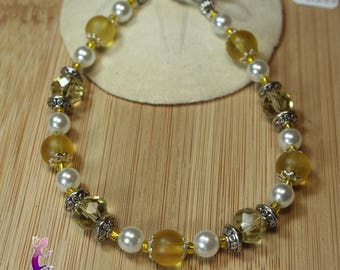 Yellow frosted and faceted glass beads and ethnic metal beads bracelet