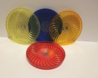 Set of 4 Rite Point Lions Club Jewel colored coasters made of plastic
