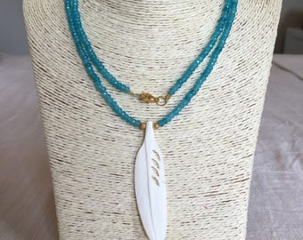 blue beaded necklace w/ feather