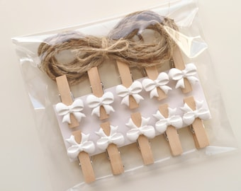 Bow clothespins, embellished pegs, white bows, mini pegs, bow pins, decorated clothespins, mini wooden pins, tiny white bows, wedding pins
