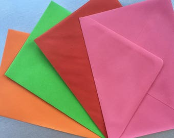 Pack of 12 or 36 brightly coloured oblong envelopes in 4 different colours. 175mm x 125mm. 7 x 5 inches. Ideal for card making, invitations.