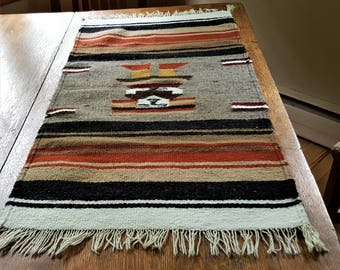 Hand Woven Mexican Style Rug All Wool 19  x 39 Earth Tone Colors Stylized Person in the Middle Rustic Decor Wall Hanging